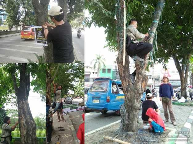 Aksi Membebaskan Pohon dari Benda Perusak di Kota Medan
