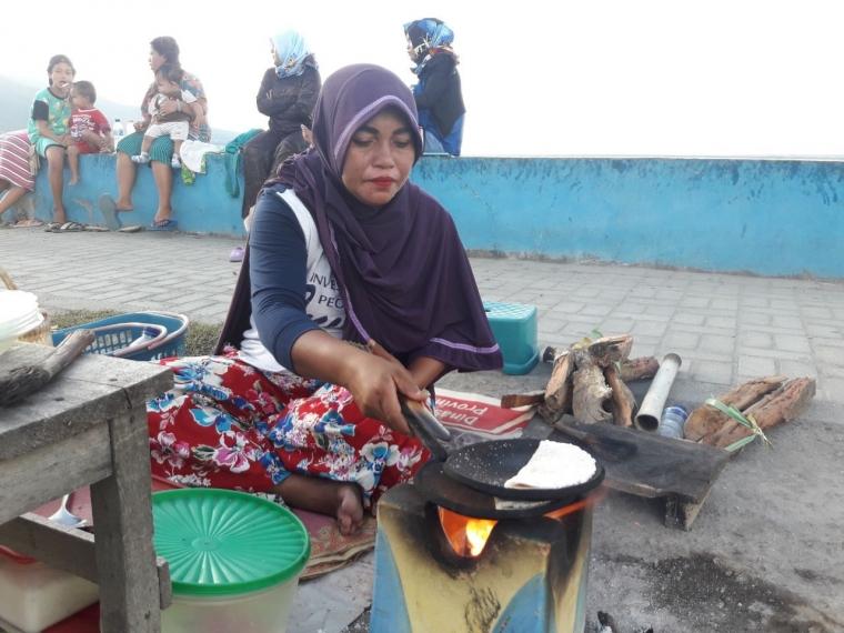 Perempuan Berkerudung, Dange Kolakola, dan Murka Tsunami di Teluk Palu