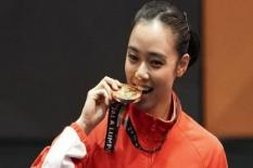 Kenapa Atlet Pemenang Olimpiade Suka Menggigit Medali Emas?